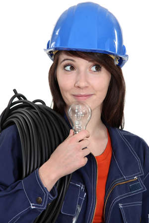 Female electrician with a lightbulb photo