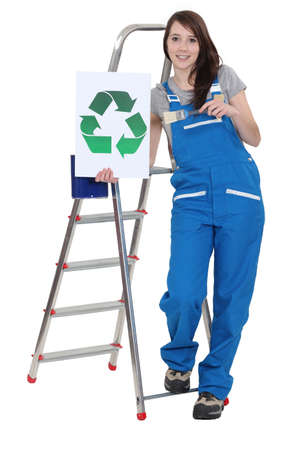 jumpsuit: Decorator holding a recycle symbol