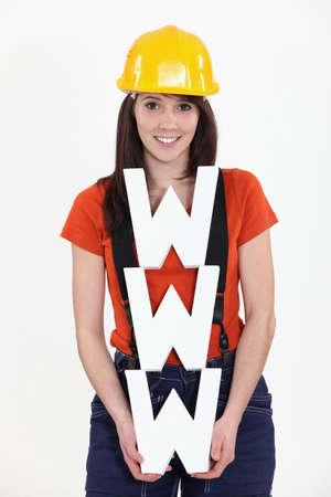 online internet presence: Construction worker holding WWW
