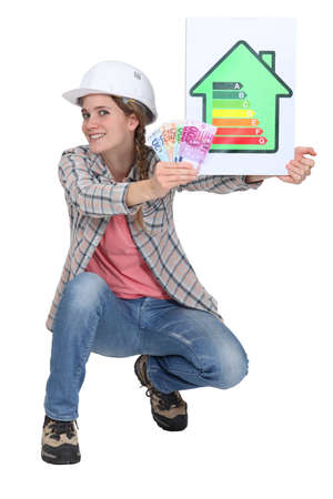 kwh: Woman laborer holding energy sign and