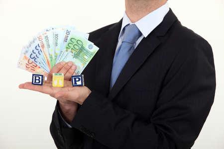 Businessman holding Euros photo