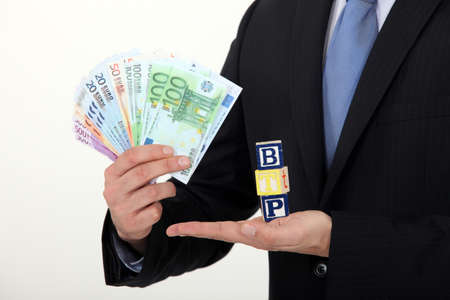 successful businessman holding money photo