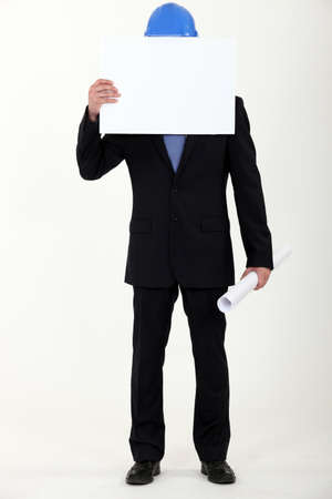 introvert: Engineer covering his face with a blank sign