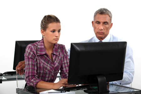 young businesswoman and her boss working together Stock Photo - 18272678