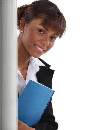 tiedup: Woman standing behind a wall