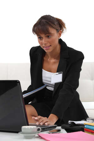 recite: Woman preparing her presentation for a conference