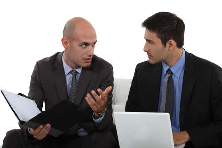 relate: two business colleagues having a discussion Stock Photo