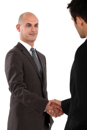 Two businessmen shaking hands photo