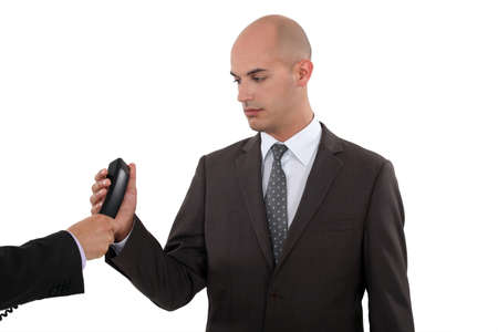 hand over: Businessman taking a phone call Stock Photo