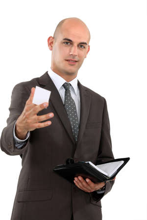 personalised: Businessman holding out his business card