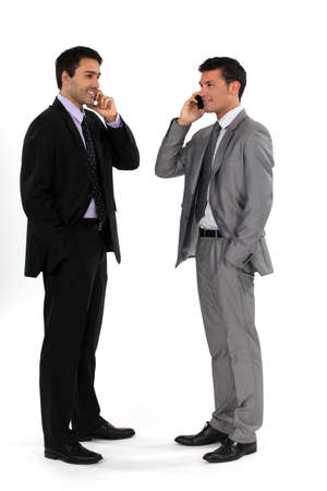 Young businessmen using cellphones photo