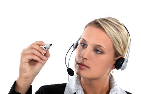 call center employee holding a marker pen photo
