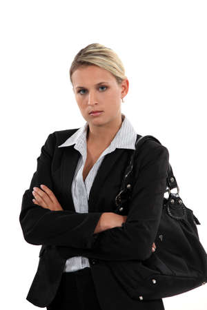 arriving: Unhappy woman arriving at work Stock Photo