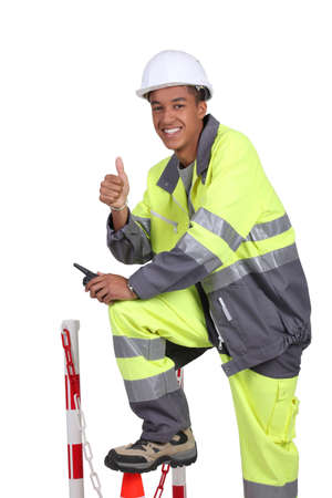 high visibility: Roadworker in fluorescent jacket and trousers