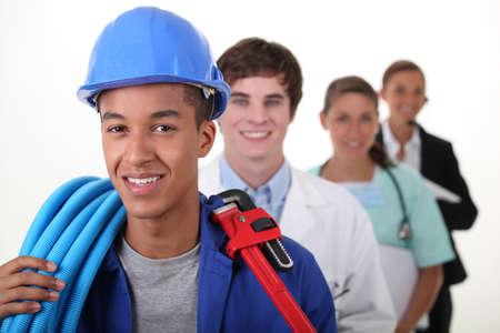 diferentes profesiones: Cuatro trabajadores con profesiones diferentes