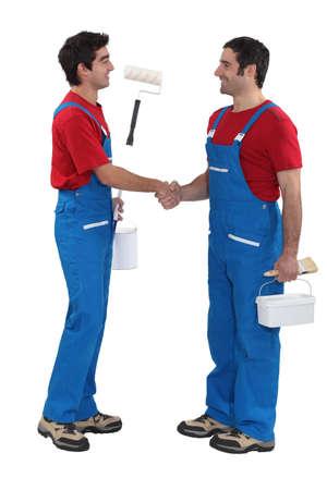 yourselfer: Housepainters handshaking Stock Photo