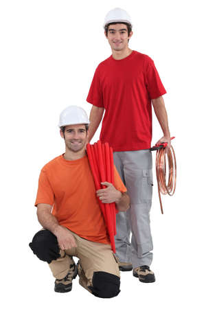 tradespeople: A team of tradespeople posing for the camera Stock Photo