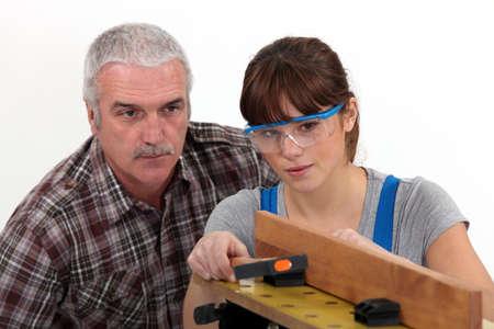 experienced: Experienced tradesman supervising his apprentice