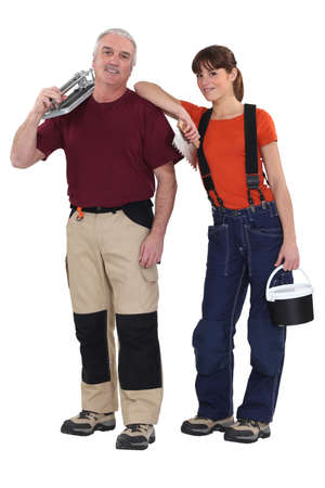 workwoman: A team of tile fitters holding tools