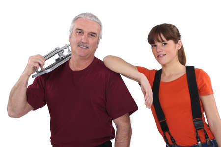 tile cutter: Couple with a tile cutter Stock Photo