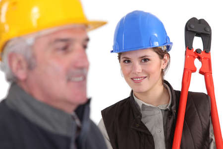 qualified worker: young female apprentice and mature mentor