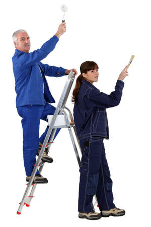 redecorating: Man and woman redecorating Stock Photo