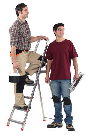 Two decorator stood with step-ladder Stock Photo - 18272673
