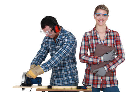 anti noise: a man using a circular saw and a woman