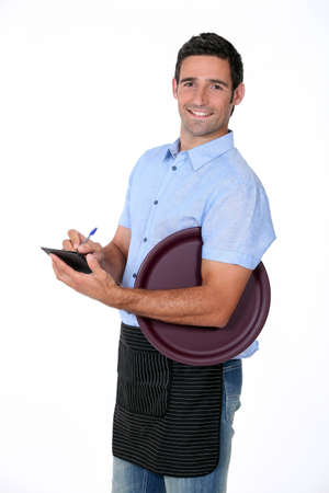 waiter tray: Casual waiter with tray and notepad Stock Photo