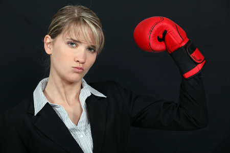 certitude: businesswoman with boxing gloves