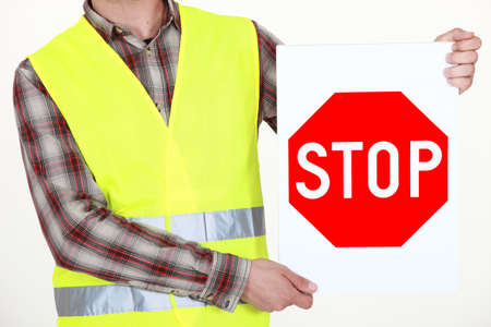 Highway worker with stop sign Stock Photo - 18304547