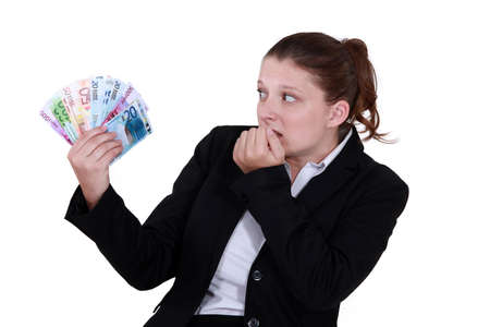 lucrative: female entrepreneur holding bunch of bank notes Stock Photo