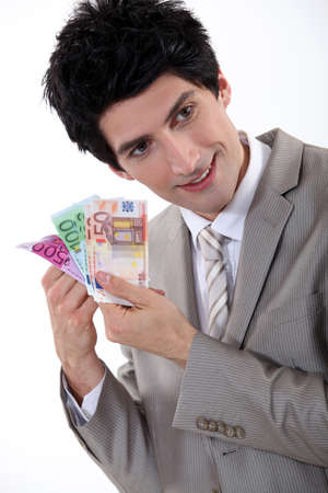 Businessman holding Euro bank notes photo