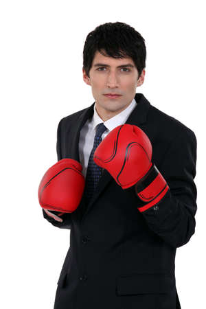 A businessman with boxing gloves. photo