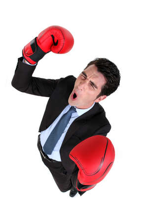 emulation: Businessman wearing boxing gloves