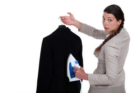 dry cleaner: Woman ironing a suit