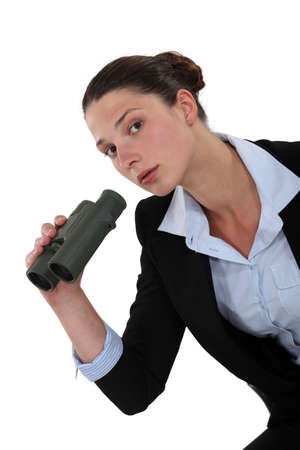 discover: Woman holding a pair of binoculars Stock Photo