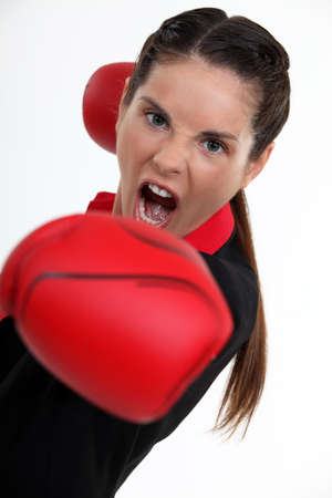 Teenage woman boxing. photo