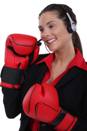 gratified: Customer service agent wearing boxing gloves