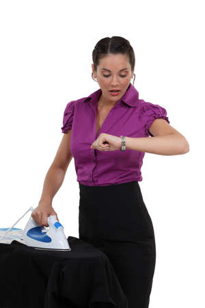 haste: Woman ironing and watching the time go by