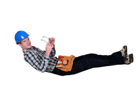 tradesman: Tradesman lying in an invisible hammock