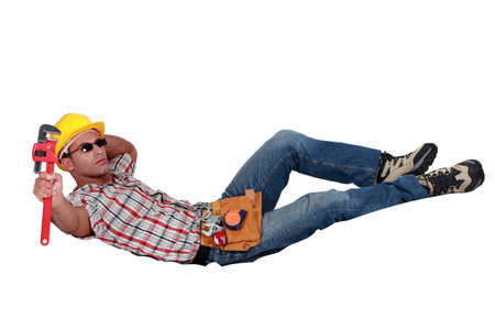 Relaxing workman with a wrench Stock Photo - 18304954