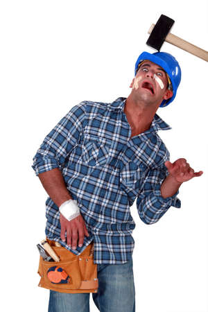 prone: Accident prone construction worker Stock Photo