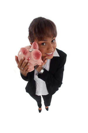Happy young businesswoman with piggy-bank photo