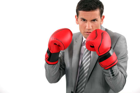 A businessman wearing boxing gloves photo