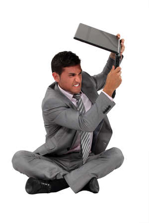 hysterics: A businessman about to smash his laptop.