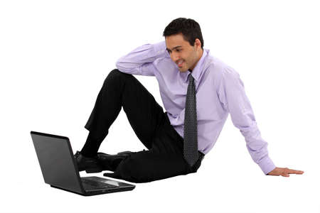 spare time: Businessman watching a movie on his laptop Stock Photo
