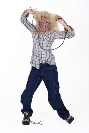 plug in: Woman receiving electric shock Stock Photo