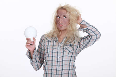yourselfer: Young woman holding light-bulb Stock Photo