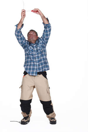 Man being electrocuted by ceiling cables Stock Photo - 18294047